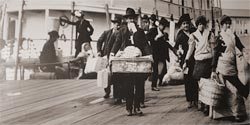 To arrive at Ellis Island
